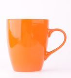 An orange mug Stock Photo