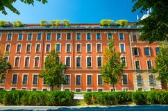 Orange multi-storey buildings with rows of windows, Milan, Italy stock image