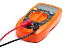 Orange multimeter on a white Stock Photos