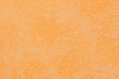 Orange murbrukväggtextur texturerad bakgrund Royaltyfri Bild