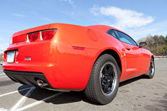 Orange Muscle Car. Rear close up of a modern orange sports car Stock Images