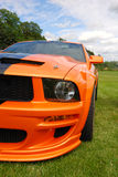 Orange muscle car. Ford mustang Royalty Free Stock Photos