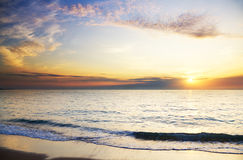 Orange mystikersolnedgång på havet Royaltyfri Bild