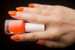Orange Nagellack lizenzfreie stockbilder