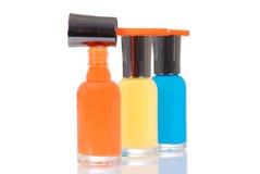 Orange nail polish brush on bottle Royalty Free Stock Photography