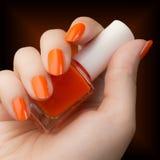 Orange nail polish Stock Images