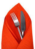 Orange napkin with knife and fork isolated. Stock Photography