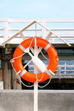 Orange, near life-saving. An orange ring at the Sopot hanging rescue Marina Royalty Free Stock Photo