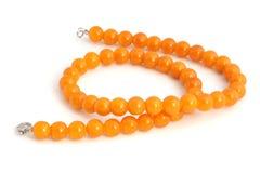 Orange necklace royalty free stock images