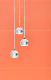 Orange negative collage of three ceiling lights Royalty Free Stock Photo