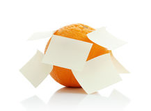 Orange with a note Stock Photography