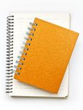 Orange Note book. On blank note book Stock Photo