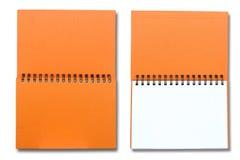 Orange note book Stock Photos