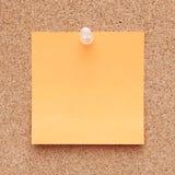 Orange note on a corkboard Royalty Free Stock Image