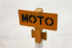 Orange note moto. On parking space specially for motor cycles Stock Images