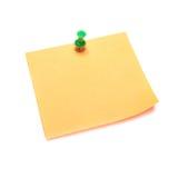 Orange note with tack. Isolated on white stock image
