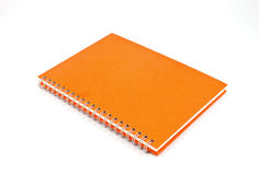 Orange notebook Stock Image