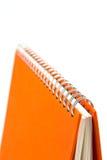 Orange notebook Stock Images
