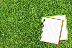 Orange notebook and Green sketch book Stock Photo