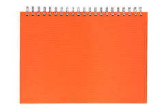 Orange notebook on a spring Royalty Free Stock Images