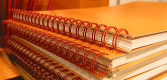Orange notebooks. Close up of orange notebooks Royalty Free Stock Photos