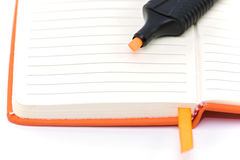 Orange notepad and marker Royalty Free Stock Photography