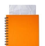 Orange Notizbuch Stockbild