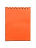 Orange Notizbuch Lizenzfreie Stockbilder
