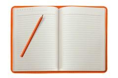 Orange Notizbuch mit einem Bleistift Stockbild