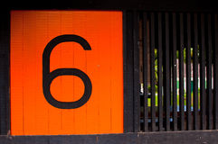 Orange Number Six. A big painted orange number six on a sign royalty free stock photo