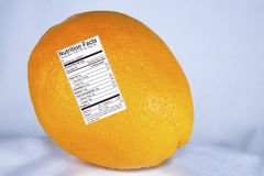 Orange with Nutrition Label Stock Photo