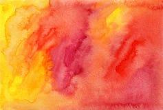 Orange och röd vattenfärg målad bakgrund Arkivbild