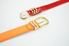 Orange och röda bälten Arkivfoton
