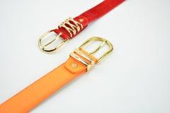 Orange och röda bälten Fotografering för Bildbyråer