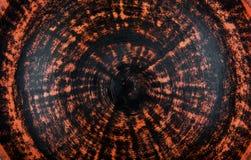 Orange och svart spiral lera texturerad bakgrund royaltyfria foton