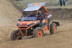 Orange off road car in the turn in terrain Stock Photos