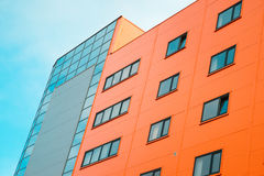 Orange office building with blue sky at background Royalty Free Stock Photography