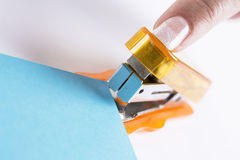 Orange office stapeler Stock Photo