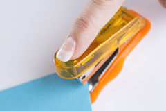 Orange office stapeler Stock Images
