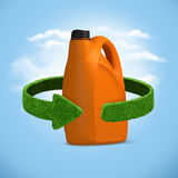 Orange oil canister recycle concept on blue sky background Royalty Free Stock Images