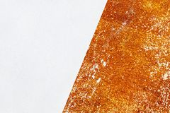 Orange old concrete wall with shabby paint and fresh plaster. royalty free stock image