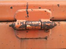 Orange old hinge Royalty Free Stock Photo