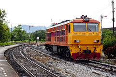 Orange old locomotive. Old locomotive in the morning Royalty Free Stock Image