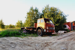 Orange old lorry stay at the tree. Summer Royalty Free Stock Photos