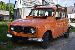 The orange old model of Renault four stock images