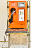Orange Old Public telephone Stock Photography