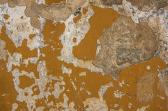 Orange old wall with the elements of destruction. Royalty Free Stock Photo