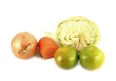Orange, onion, carrot and cabbage. On white background Stock Images