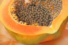 Orange open papaya with black seeds. Papaya close-up. Fruits of. Asia, healthy food, natural fruits Stock Photography