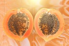 Orange open papaya with black seeds. Papaya close-up. Fruits of. Asia, healthy food, natural fruits Stock Image